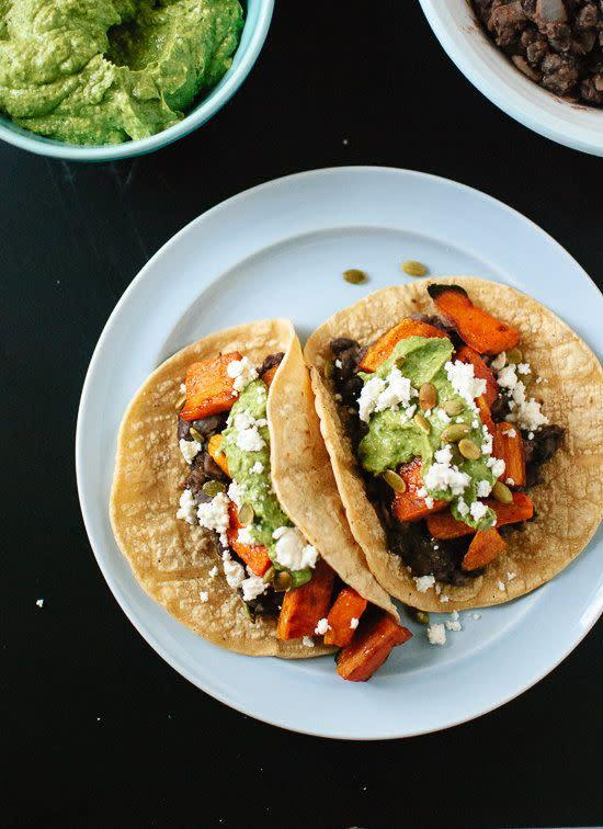 "<strong>Get the <a href=""http://cookieandkate.com/2014/sweet-potato-and-black-bean-tacos-with-avocado-pepita-dip/"" rel=""nofollow noopener"" target=""_blank"" data-ylk=""slk:Sweet Potato and Black Bean Tacos with Avocado-Pepita Dip recipe"" class=""link rapid-noclick-resp"">Sweet Potato and Black Bean Tacos with Avocado-Pepita Dip recipe</a>&nbsp;from Cookie + Kate</strong>"