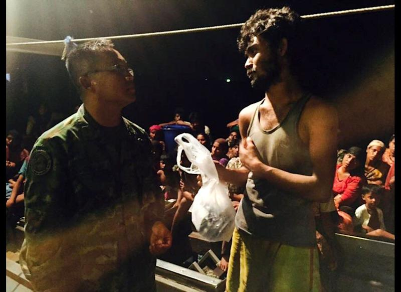 A Rohingya refugee pleads with a military officer for more aid after being found in the Andaman Sea. JRS believes that accompanying refugees and being there for them bears witness to our common humanity — listening to the unheard and soft spoken is a cornerstone of accompanying refugees to ensure they are shown hospitality and are treated with dignity. (Thapanee Letsrichai)