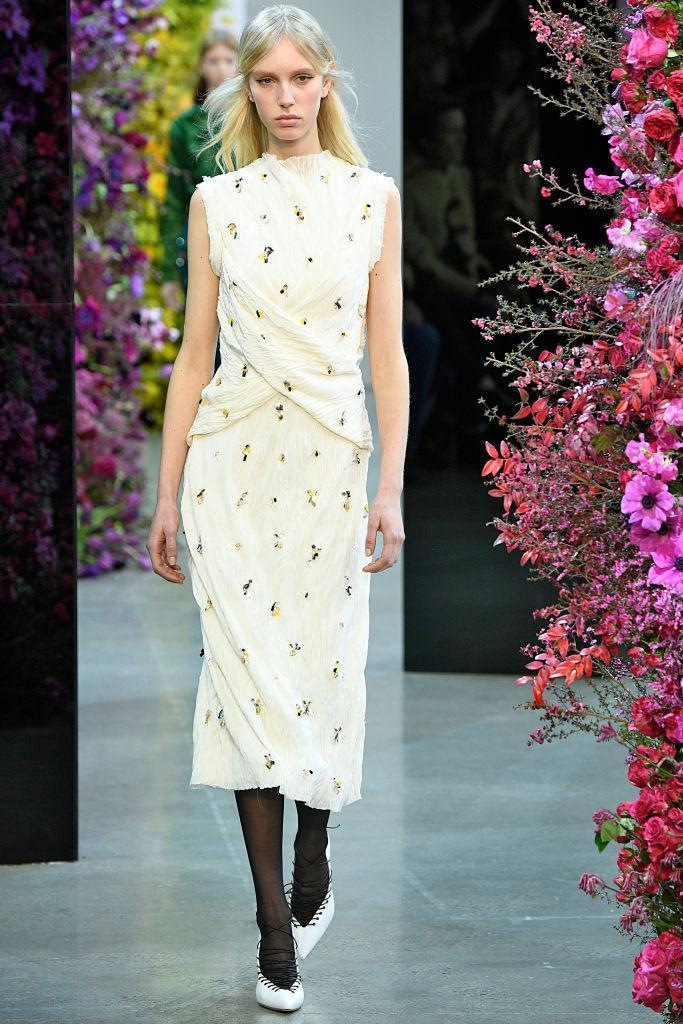 <p>A sleeveless cream dress with embellishments at the Jason Wu FW18 show. (Photo: Getty) </p>