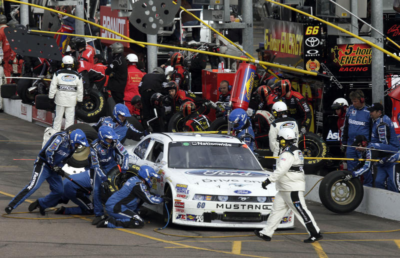 Driver Carl Edwards stops for a pit stop during a NASCAR Nationwide Series car race at Phoenix International Raceway Saturday, Feb. 26, 2011, in Avondale, Ariz. (AP Photo/Jason Babyak)