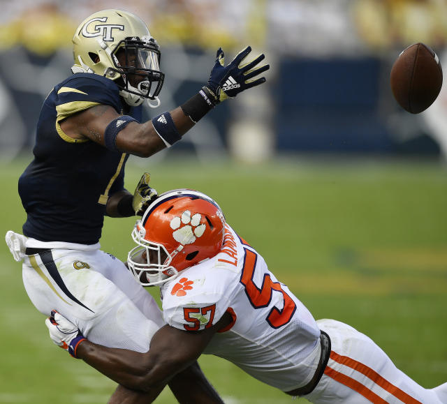 Clemson linebacker Tre Lamar (57) hits Georgia Tech running back Qua Searcy (1) causing a fumble during the first half of an NCAA college football game, Saturday, Sept. 22, 2018, in Atlanta. Clemson defensive end Clelin Ferrell picked up the ball in the end zone for a touchdown. (AP Photo/Mike Stewart)