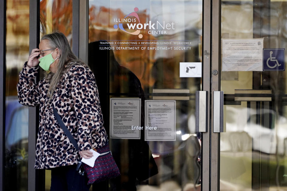 A woman reacts as she leaves after she checked information signs at IDES (Illinois Department of Employment Security) WorkNet center in Arlington Heights, Ill., Thursday, Nov. 5, 2020. Illinois reports biggest spike in unemployment claims of all states. (AP Photo/Nam Y. Huh)