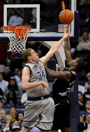 Cincinnati's Sean Kilpatrick goes up for a shot against Georgetown's Nate Lubick (34) during second half of an NCAA college basketball game Monday, Jan. 9, 2012, in Washington. Cincinnati defeated Georgetown 68-64. (AP Photo/Richard Lipski)