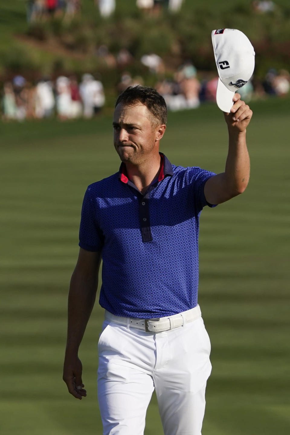 Justin Thomas waves on the 18th green after the final round of The Players Championship golf tournament Sunday, March 14, 2021, in Ponte Vedra Beach, Fla. (AP Photo/John Raoux)