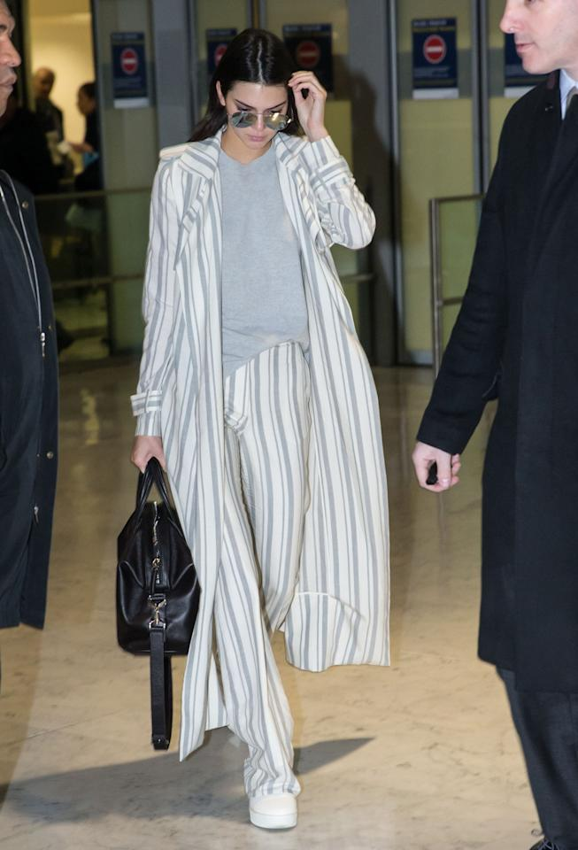"<p>'Oversized' isn't typically the word we'd use to describe Kendall Jenner's clothing—but for a Friday flight to Paris, the model traded in her shrunken crop tops for a stripy Sally LaPointe look that more closely resembled old fashioned men's pajamas. But the total cost of the pieces—an <a href=""http://www.celebuzz.com/2016-01-21/kendall-jenner-airport-outfit-style-fashion-sally-lapointe-star-sightings/"">estimated $5,370</a>!—is far above what most people would be willing to pay for sleepwear. For that price, we sure hope she had a comfortable plane ride. <i>(Photo: FameFlynet)</i></p>"