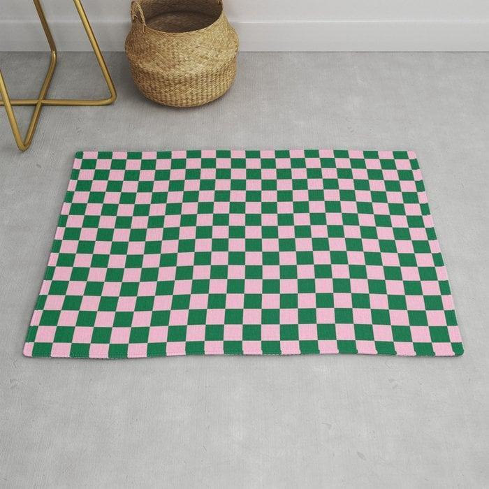 <p>This <span>Cotton Candy Pink and Cadmium Green Checkerboard Rug</span> ($39, originally $49) will add some playfulness to any room.</p>