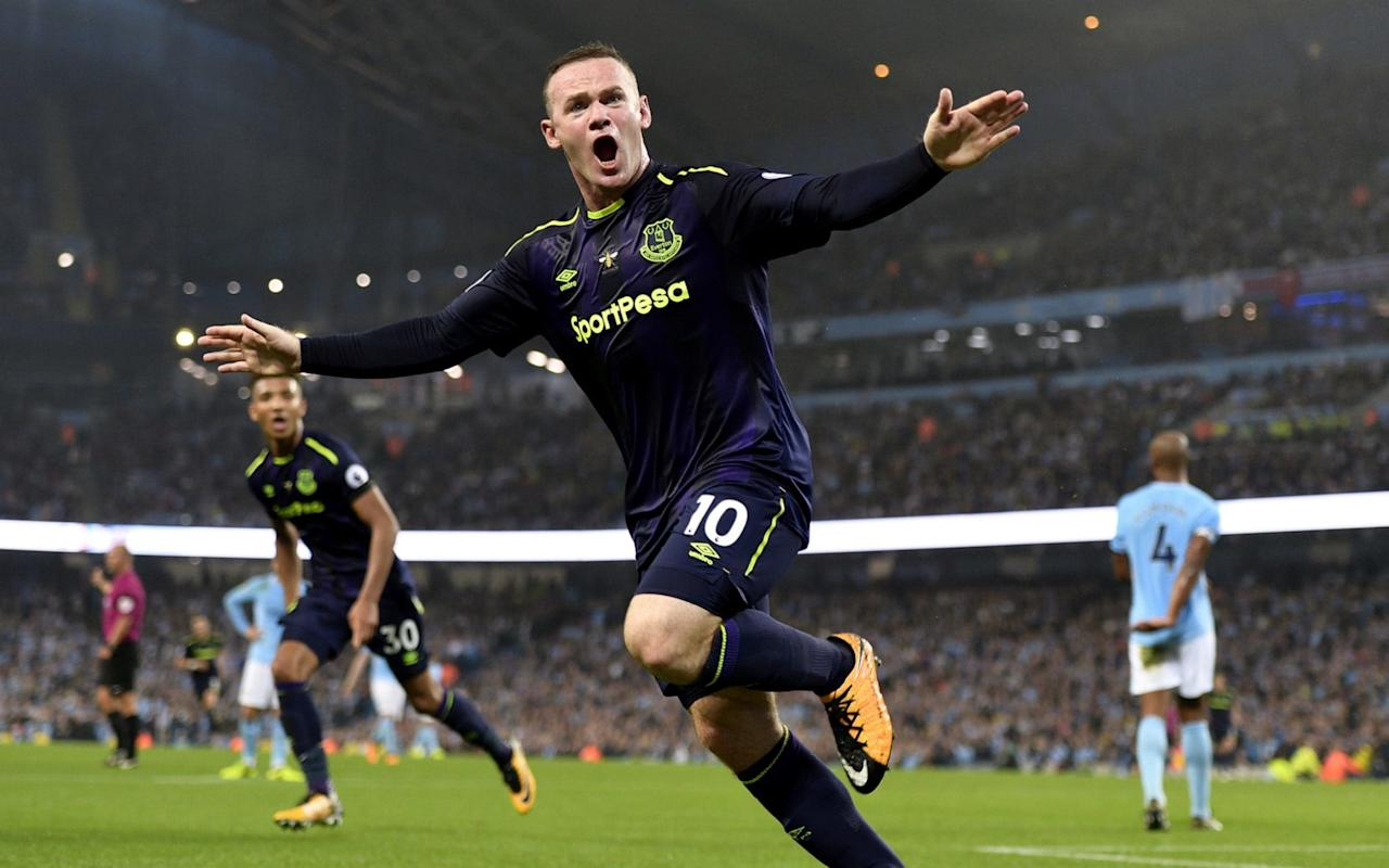 Wayne Rooney joined an extremely exclusive club on Monday evening as he scored his 200th Premier League goal.  Only Alan Shearer has scored more than Rooney, who hit the landmark with a sidefoot shot inside the area against Manchester City, with the ex-Newcastle striker a fair way out in front on 260. Newcastle have been Rooney's favourite opponents in England, having scored 14 of his 200 goals against Shearer's old club. Aston Villa have felt the force of Rooney 13 times and his current employers, Everton, have had to endure their favourite sign scoring five times against them.  Manchester United are one of very few clubs that he hasn't scored against. Yet. Each of Rooney's 13 seasons with Manchester United: ranked After breaking into the Everton first team in the 2002/03 season, Rooney went on to score six goals. In 2003/04 it was nine and then came that big money move to Manchester United, where he went on to beat Sir Bobby Charlton's record and become the Old Trafford club's all time top scorer. Rooney celebrates a goal against Manchester City in 2012 Credit: GETTY IMAGES The most he's ever scored in one season is 27, done in the 2011/12 season, and his preferred stadium to hit the back of the net in, is (unsurprisingly) Old Trafford. 101 of his Premier League goals have been scored in the Theatre of Dreams, 11 at Goodison Park and eight have been at St James' Park - his third favourite hunting ground. Rooney has scored six hat-tricks in total, doing so twice against Bolton (in different matches), and once each against Portsmouth, Hull, West Ham and Arsenal - the latter of which he also happened to score his very first Premier League goal against. The majority of his goals have been with the right foot, 173 of them have been scored inside the penalty area, seven from direct free-kicks and only 20 from the penalty spot.