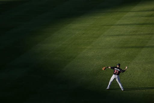 Atlanta Braves' Joey Terdoslavich tosses back a ball from the outfield during batting practice before a spring training baseball game against the New York Yankees, Tuesday, March 5, 2013, in Tampa, Fla. (AP Photo/Matt Slocum)