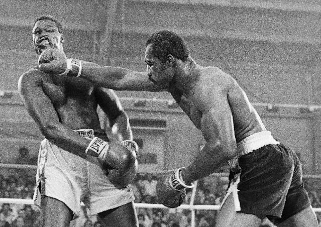 "CORRECTS ORDER OF IDS - FILE - In this June 9, 1978, file photo, Ken Norton, right, and Larry Holmes battle for the WBC heavyweight championship at Caesars Palace in Las Vegas. Holmes won the bout in a 15-round split decision. Norton passed away Wednesday, Sept. 18, 2013, at a Las Vegas care facility, his son said. Norton was 70. Norton had been in poor health for the last several years after suffering a series of strokes, a friend of his said. Gene Kilroy, who was Ali's former business manager, says he's sure Norton is ""in heaven now with all the great fighters."" (AP Photo/File) (AP Photo/File)"