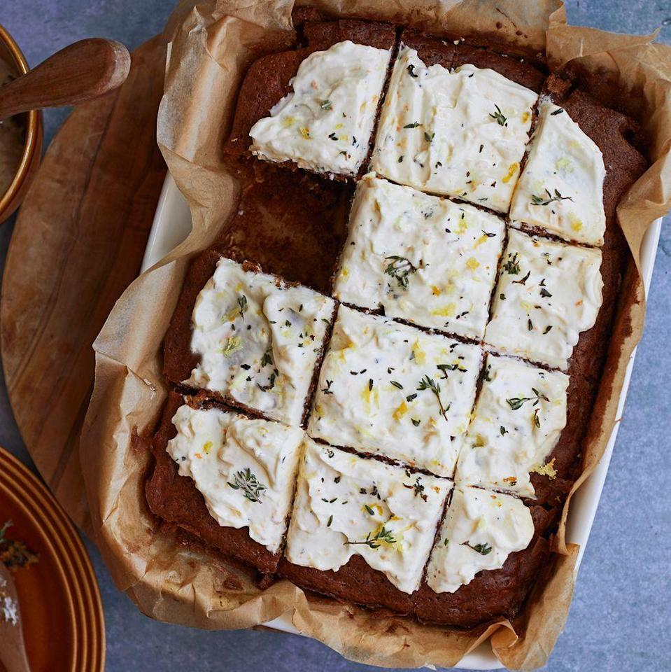 """<p><a href=""""https://www.delish.com/uk/cooking/recipes/g33521348/best-carrot-cake-recipes/"""" rel=""""nofollow noopener"""" target=""""_blank"""" data-ylk=""""slk:Carrot cake"""" class=""""link rapid-noclick-resp"""">Carrot cake</a> traybake is one of our favourite springtime <a href=""""https://www.delish.com/uk/cooking/recipes/g31433515/best-cake-recipes/"""" rel=""""nofollow noopener"""" target=""""_blank"""" data-ylk=""""slk:bakes"""" class=""""link rapid-noclick-resp"""">bakes</a> to make. The ricotta frosting is a deliciously light and tangy twist on the classic cream cheese topping. Thyme might sound unusual here but the subtle herbal flavour works perfectly with the warming spices and <a href=""""https://www.delish.com/uk/cooking/recipes/a34445804/chocolate-orange-doughnuts/"""" rel=""""nofollow noopener"""" target=""""_blank"""" data-ylk=""""slk:orange"""" class=""""link rapid-noclick-resp"""">orange</a> flavour in the cake.</p><p>Get the <a href=""""https://www.delish.com/uk/cooking/recipes/a35305446/carrot-cake-traybake/"""" rel=""""nofollow noopener"""" target=""""_blank"""" data-ylk=""""slk:Carrot Cake Traybake"""" class=""""link rapid-noclick-resp"""">Carrot Cake Traybake</a> recipe.</p>"""