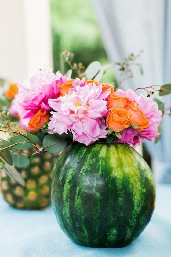 """<p>Robust watermelons or hollowed-out pineapple rinds make for the sweetest vases.</p><p><em><a href=""""https://www.hgtv.com/shows/10-tips-for-easy-entertaining/10-ways-to-take-your-outdoor-party-to-the-next-level-pictures"""" rel=""""nofollow noopener"""" target=""""_blank"""" data-ylk=""""slk:Get the tutorial at HGTV »"""" class=""""link rapid-noclick-resp"""">Get the tutorial at HGTV »</a></em> </p>"""