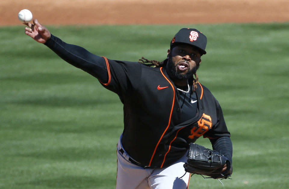 TEMPE, ARIZONA - MARCH 11: Starting pitcher Johnny Cueto #47 of the San Francisco Giants throws against the Los Angeles Angels during the second inning of the MLB spring training baseball game at Tempe Diablo Stadium on March 11, 2021 in Tempe, Arizona. (Photo by Ralph Freso/Getty Images)