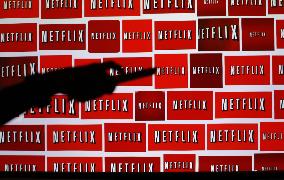 The Netflix logo is shown in this illustration photograph in Encinitas, California October 14, 2014. Netflix Inc <NFLX.O> shares were down 3.1 percent at $435.28 after the announcement. The streaming video company will announced its quarterly results later on October 15. Picture taken October 14, 2014. REUTERS/Mike Blake (UNITED STATES - Tags: ENTERTAINMENT MEDIA BUSINESS LOGO)
