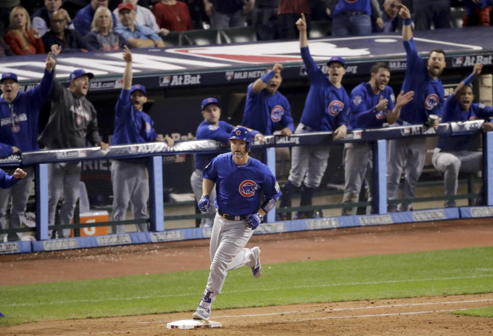 FILE - In this Nov. 2, 2016, file photo, Chicago Cubs' David Ross rounds the bases after hitting a home run against the Cleveland Indians during the sixth inning of Game 7 of the Major League Baseball World Series in Cleveland. The Chicago Cubs have hired former catcher David Ross to replace Joe Maddon as their manager, hoping he can help them get back to the playoffs after missing out for the first since 2014. (AP Photo/Charlie Riedel, File)