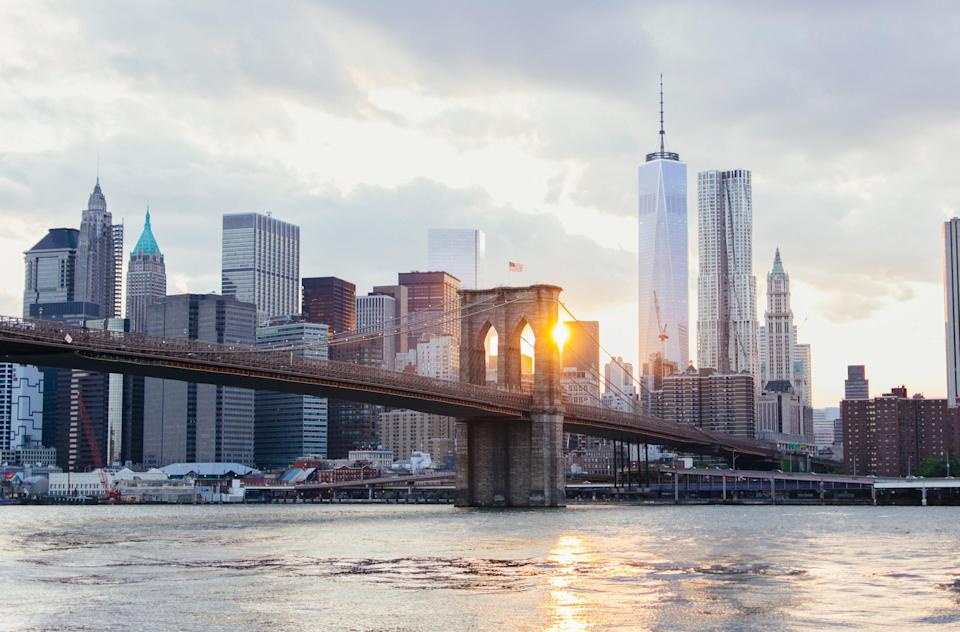 """<p><strong>Tell me: What's this place all about?</strong><br> When the Brooklyn Bridge was constructed in 1883—extending 1,595 feet across the East River, connecting lower Manhattan to Brooklyn Heights—it was the longest suspension bridge in the world. Now, it's a historic staple of the New York City skyline, transporting commuter car traffic underneath and <a href=""""https://www.cntraveler.com/story/scenic-spacious-nyc-strolls-to-keep-you-sane?mbid=synd_yahoo_rss"""" rel=""""nofollow noopener"""" target=""""_blank"""" data-ylk=""""slk:touristic foot traffic"""" class=""""link rapid-noclick-resp"""">touristic foot traffic</a> above.</p> <p><strong>And what's it like being there?</strong><br> Spirit-lifting awe.</p> <p><strong>Is there a guide involved?</strong><br> There are a number of tour operators offering one- or two-hour guided walks or bike rides across the Brooklyn Bridge, but it's easy to plan a self-guided tour if you prefer to save money and/or time. The overwhelming city views are what you'll take away from a visit here, guaranteed.</p> <p><strong>Who comes here?</strong><br> The two-lane outdoor path is shared by pedestrians (on the right) and bicyclists (on the left). During warmer months, when the path is crowded with tourists in leisure mode, anyone who walks with a purpose should avoid the Bridge at all costs. And everyone needs to look out for bicyclists, who drive fast and rarely slow down to maneuver around crowds.</p> <p><strong>Did it meet expectations?</strong><br> Standing before arches and rectangles with city skyscrapers rising in the distance, will at once inspire a sense of grandiosity and slightness. You'll be in awe of how such a feat of architecture could be accomplished more than a century ago and also feel an overwhelming sense of the comparative tininess of man.</p>"""