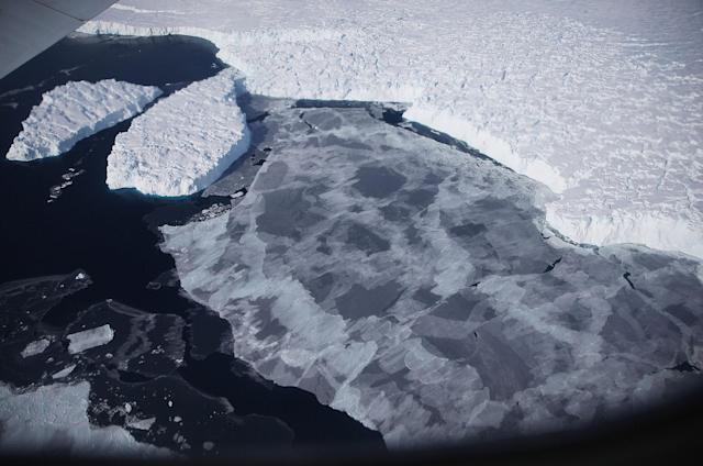 <p>Ice floats near the coast of West Antarctica as viewed from a window of a NASA Operation IceBridge airplane on October 28, 2016 in-flight over Antarctica. (Photo: Mario Tama/Getty Images) </p>