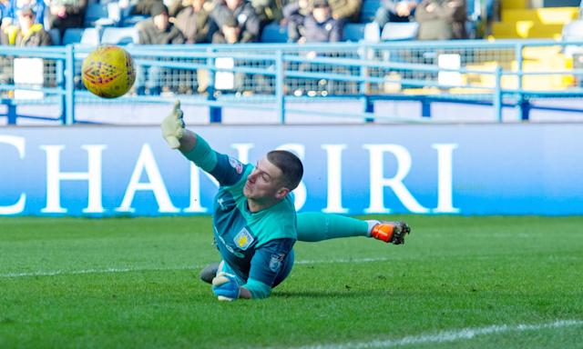 The Aston Villa goalkeeper, Sam Johnstone, on loan from Manchester United, makes a save against Sheffield Wednesday.