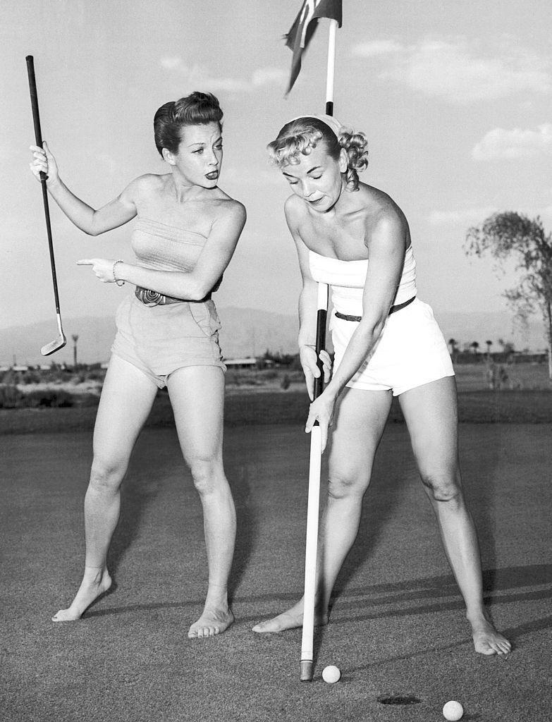 <p>Showgirls Joy Skylar and Florence Walters practice their golf game in Las Vegas prior to a showgirl golf tournament held at the Desert Inn Country Club in 1953. </p>