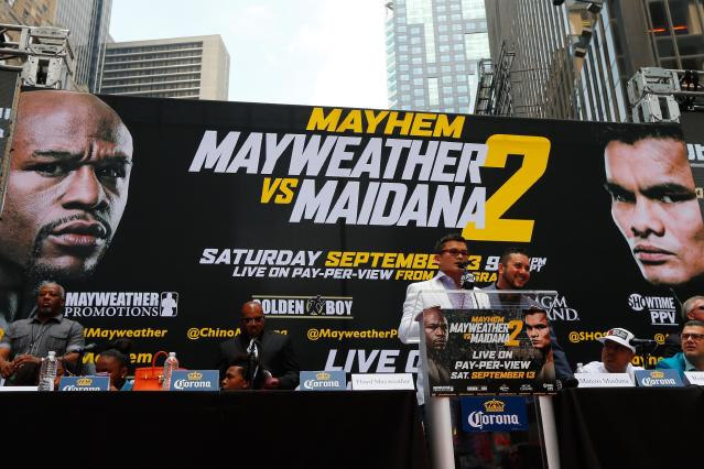 Marcos Maidana speaks to the media at the Pedestrian Walk in Times Square on July 14, 2014 in New York City (AFP Photo/Mike Stobe)