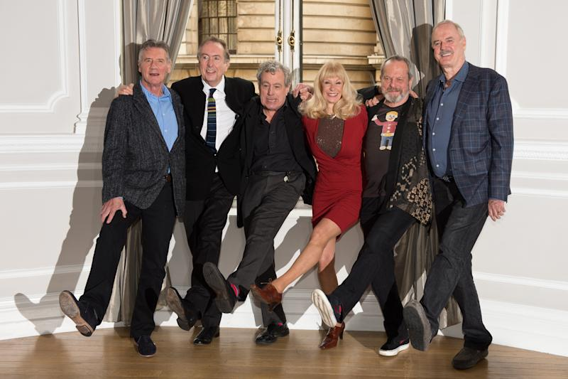 British comedy troupe Monty Python, (L-R) Michael Palin, Eric Idle, Terry Jones, Carol Cleveland, Terry Gilliam and John Cleese pose for a photograph during a media event in central London on November 21, 2013. Cue endless jokes about resting parrots -- the five surviving members of Monty Python, Britain's cult comedy troupe, announced on November 21 they will take to the stage again next year, three decades after their last performance together. AFP PHOTO / LEON NEAL (Photo credit should read LEON NEAL/AFP via Getty Images)