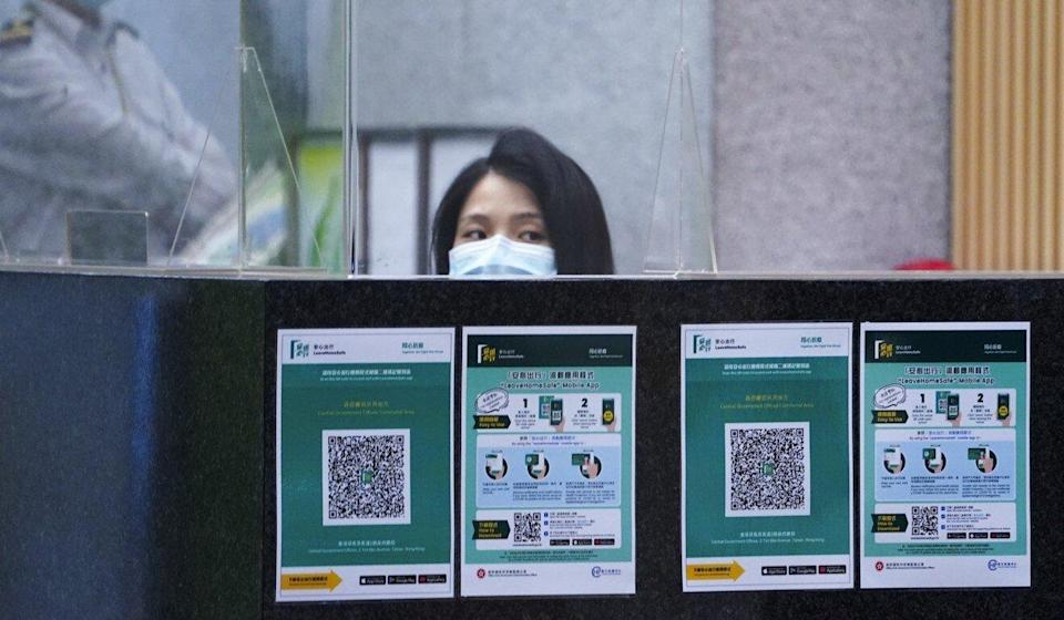 QR codes for the 'Leave Home Safe' app on display at government headquarters. Photo: Felix Wong