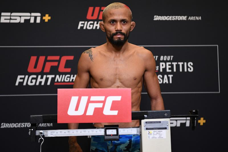 Deiveson Figueiredo of Brazil poses on the scale during the UFC Fight Night weigh-in at Hilton Franklin Cool Springs on March 22, 2019 in Franklin, Tennessee. (Photo by Jeff Bottari/Zuffa LLC/Zuffa LLC via Getty Images)