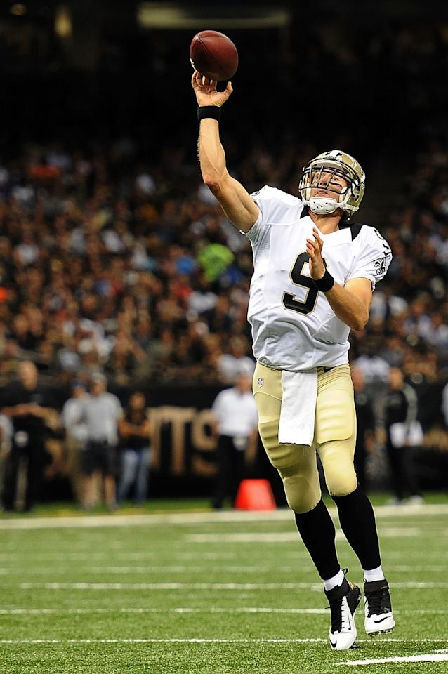 NEW ORLEANS, LA - AUGUST 16: Drew Brees #9 of the New Orleans Saints throws a pass against the Oakland Raiders during a preseason game at the Mercedes-Benz Superdome on August 16, 2013 in New Orleans, Louisiana. (Photo by Stacy Revere/Getty Images)
