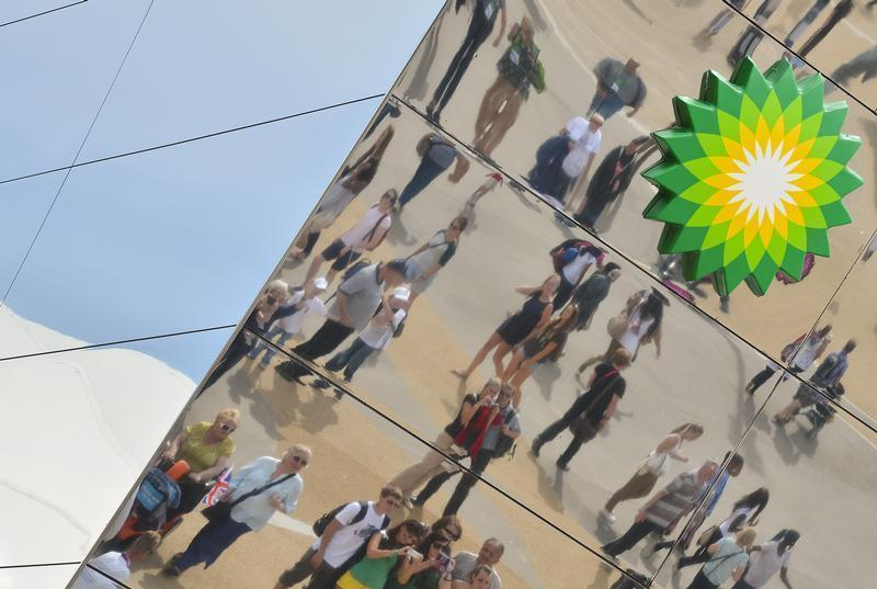 Spectators are seen reflected in a British Petroleum sponsors building in Olympic Park at the London 2012 Paralympic Games