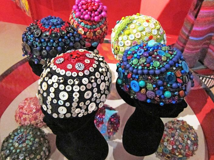 "This publicity photo provided by Kaffe Fassett Studio shows textile artist Kaffe Fassett's crocheted skull caps, which are embellished with buttons and beads. Dozens of similar caps appeared in the show ""Kaffe Fassett: A Life in Colour"" recently at the Fashion and Textile Museum in London. Today's crochet is leaner and trendier than that of the 1960s and '70s, from which we know it for its bulky, acrylic yarns and Afghan blankets. (AP Photo/Kaffe Fassett Studio)"