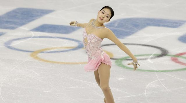 Li Zijun of China competes in the women's free skate figure skating finals at the Iceberg Skating Palace during the 2014 Winter Olympics, Thursday, Feb. 20, 2014, in Sochi, Russia. (AP Photo/Darron Cummings)