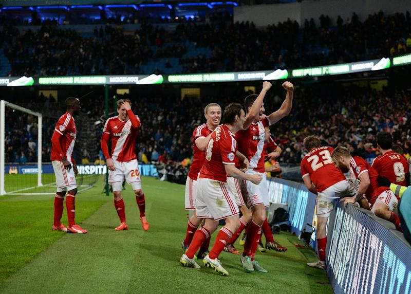 Middlesbrough's players celebrate a goal during a football match at the Etihad Stadium in Manchester, England, on January 24, 2015