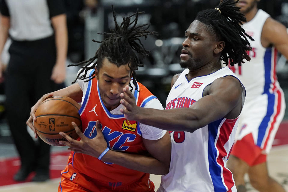 Oklahoma City Thunder center Moses Brown is defended by Detroit Pistons center Isaiah Stewart (28) during the first half of an NBA basketball game, Friday, April 16, 2021, in Detroit. (AP Photo/Carlos Osorio)