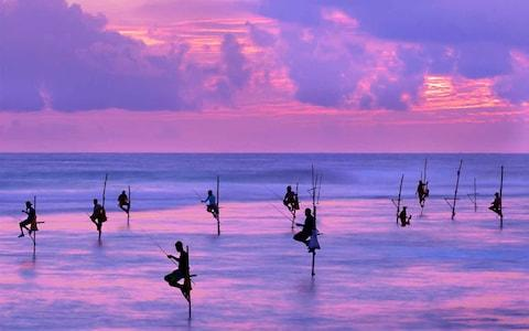 Fisherman at dusk in Galle - Credit: istock