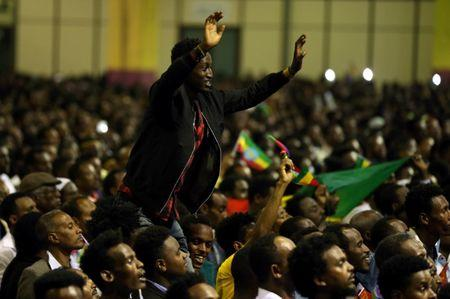 A resident cheers as he attends a concert at the Millennium Hall in Addis Ababa, Ethiopia July 15, 2018. REUTERS/Tiksa Negeri