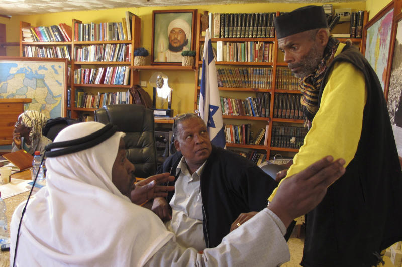 In this photo taken Tuesday, March 6, 2012, from right to left, Sheik Ayed al-Abed and Mohammed al-Masri and Khazrail Ben-Yehuda talk in a meeting room in the southern Israeli city of Dimona. For years, Israel's array of African communities had little interaction, divided by religious, linguistic and cultural differences that made it impossible to think about one another. But in an unprecedented gathering, some members of these communities, including Jewish Ethiopians, nomadic Muslim Arabs and migrants from Eritrea and Sudan are banding together, claiming their shared skin tone has given them a common experience of discrimination. (AP Photo/Diaa Hadid)