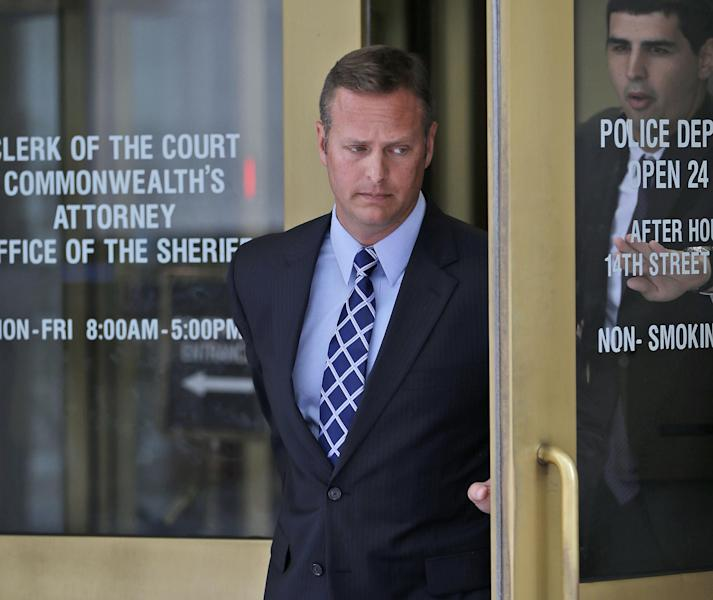 Lt. Col. Jeffrey Krusinski, who led the Air Force's Sexual Assault Prevention and Response unit, is seen leaving the Arlington County General District Court, Thursday, July 18, 2013 in Arlington, Va. Krusinski, who is accused of groping a woman in a Crystal City parking lot, had a scheduled trial on a charge of misdemeanor sexual battery, but Virginia prosecutors have dropped a sexual battery charge against him and substituted with a generic assault charge. (AP Photo/Pablo Martinez Monsivais)