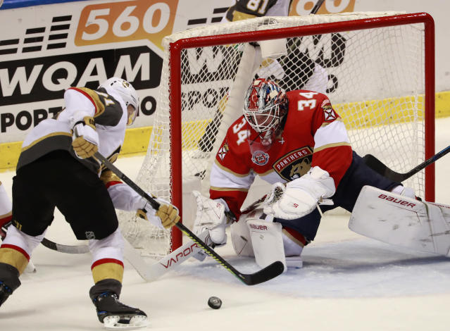 Vegas Golden Knights center William Karlsson, left, attempts to shoot at Florida Panthers goaltender James Reimer (34) during the second period of an NHL hockey game, Saturday, Feb. 2, 2019, in Sunrise, Fla. (AP Photo/Wilfredo Lee)