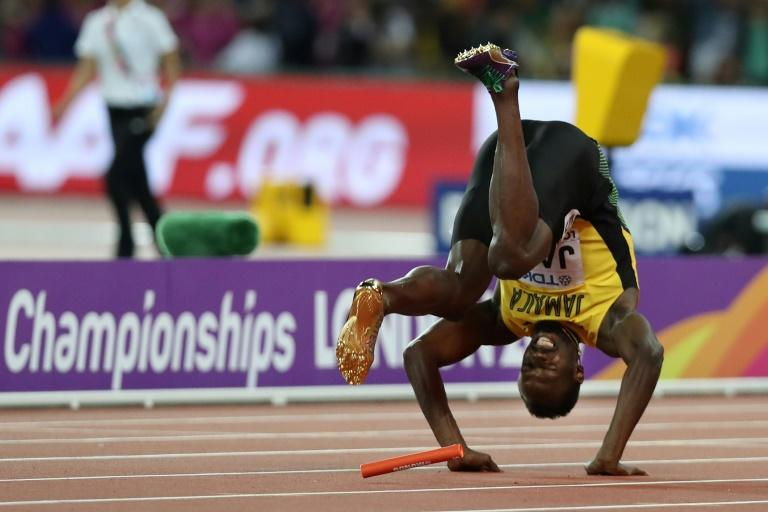 Jamaica's Usain Bolt falls after injuring himself in the final of the men's 4x100m relay at the 2017 IAAF World Championships at the London Stadium in London on August 12, 2017