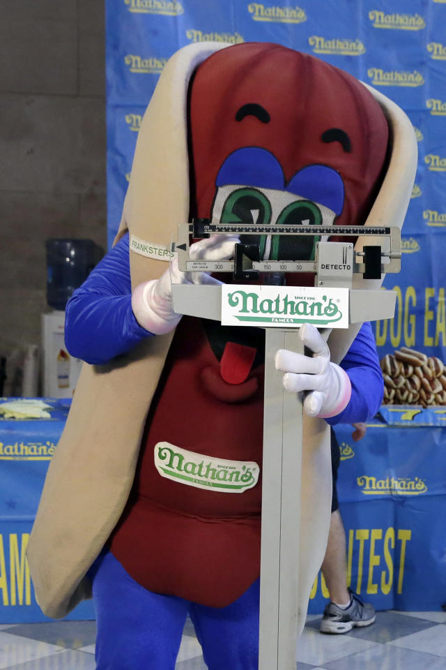<p>The Nathan's character poses for photos on the scale during the weigh-in for the 2017 Nathan's Hot Dog Eating Contest, in Brooklyn Borough Hall, in New York, Monday, July 3, 2017. (AP Photo/Richard Drew) </p>
