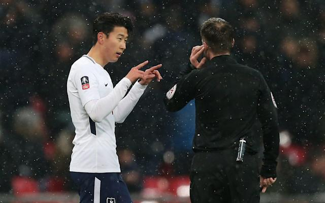 """If this was a glimpse into the future, when the machines take over and nothing is left to chance, then football fans may as well save their money and let the robots get on with it. For while the video assistant referee (VAR) may have been right, by the letter of the law, the Tottenham Hotspur and Rochdale supporters who braved the freezing Wembley weather were largely left clueless. It was the FA Cup, but not as we know it. Spurs booked a quarter-final date against Swansea City thanks to a Fernando Llorente hat-trick, a Son Heung-min double and a late goal from substitute Kyle Walker-Peters, while Rochdale's Stephen Humphrys left with a treasured Wembley memory. However, this fifth-round replay and Llorente's treble were overshadowed by the constant use of VAR that resulted in Spurs fans booing with each pause in the proceedings. """"The first half was a bit embarrassing for everyone,"""" said Tottenham manager Mauricio Pochettino. """"I am not sure that the system is going to help. Football is about emotion. It is a contest of emotion and if we are going to kill emotion in football, the fans, the people who love football, are not so happy about what they saw. """"Football is about making a mistake. Like us, we made a mistake, the player has made a mistake, the referee can make a mistake. It was always like this. We try in this situation to change the game that we love. That is why I am open to help and to try to change and analyse and try to make it better if we are going to use this system. I think you and the fans and myself, we all agree that, watching today's game, maybe it is so early for next season. Go on my son: Tottenham Hotspur's South Korean striker Son Heung-Min was involved in controversy Credit: AFP Getty """"I think you are going to kill that emotion that makes you feel happy. That is why you pay for the ticket, that is why you came to the game when the conditions were so bad. Then you say, 'OK, I am going to watch the game through the TV and stay at home because i"""