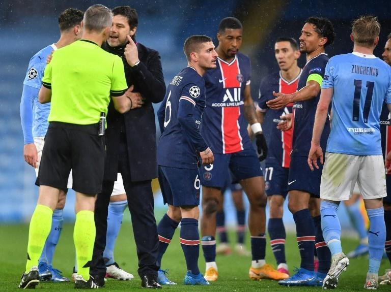 PSG coach Mauricio Pochettino remonstrates with referee Bjorn Kuipers after Angel Di Maria was sent off