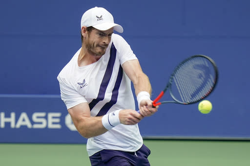 Andy Murray, of Great Britain, returns a shot to Yoshihito Nishioka, of Japan, during the first round of the US Open tennis championships, Tuesday, Sept. 1, 2020, in New York. (AP Photo/Seth Wenig)