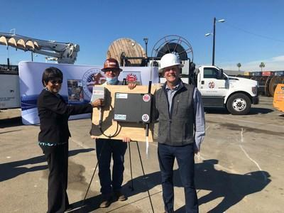 (Left) Olivia Valentine, Chair, South Bay Cities Council of Governments (SBCCOG), and City of Hawthorne Councilmember, (right) Dave Daigle, CEO, American Dark Fiber, and (behind), Mark Hines, Operations Manager, American Dark Fiber