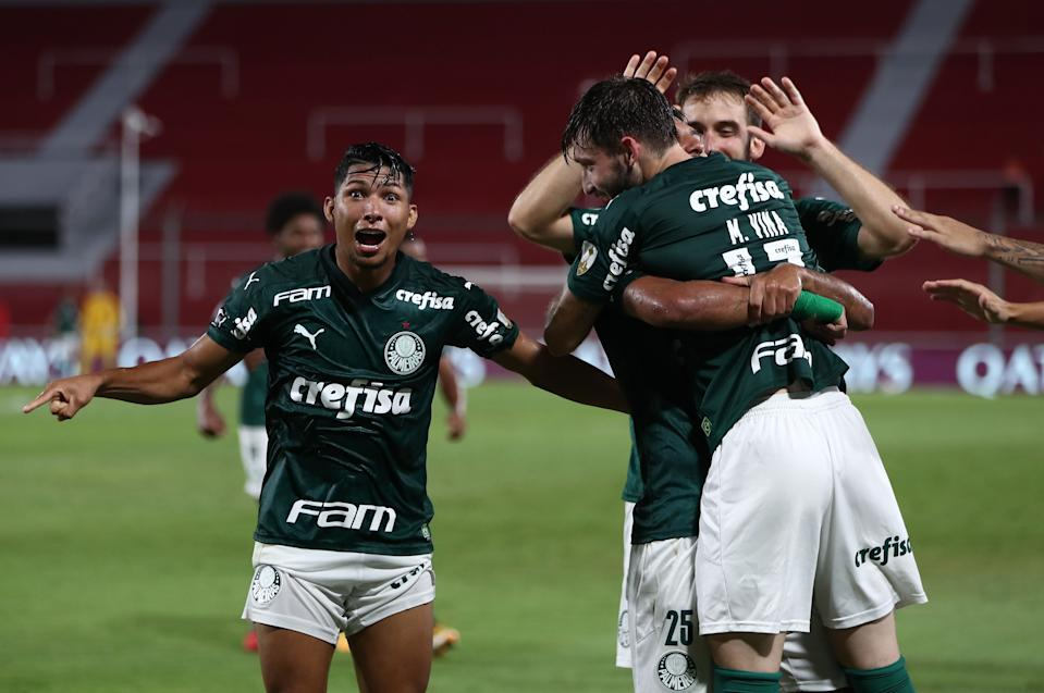 Brazil's Palmeiras Rony (L) gestures as Uruguayan teammate Matias Vina (R) celebrates after scoring a header against Argentina's River Plate during their Copa Libertadores semifinal football match at the Libertadores de America stadium in Avellaneda, Buenos Aires Province, Argentina, on January 5, 2021. (Photo by Juan Ignacio RONCORONI / POOL / AFP) (Photo by JUAN IGNACIO RONCORONI/POOL/AFP via Getty Images)