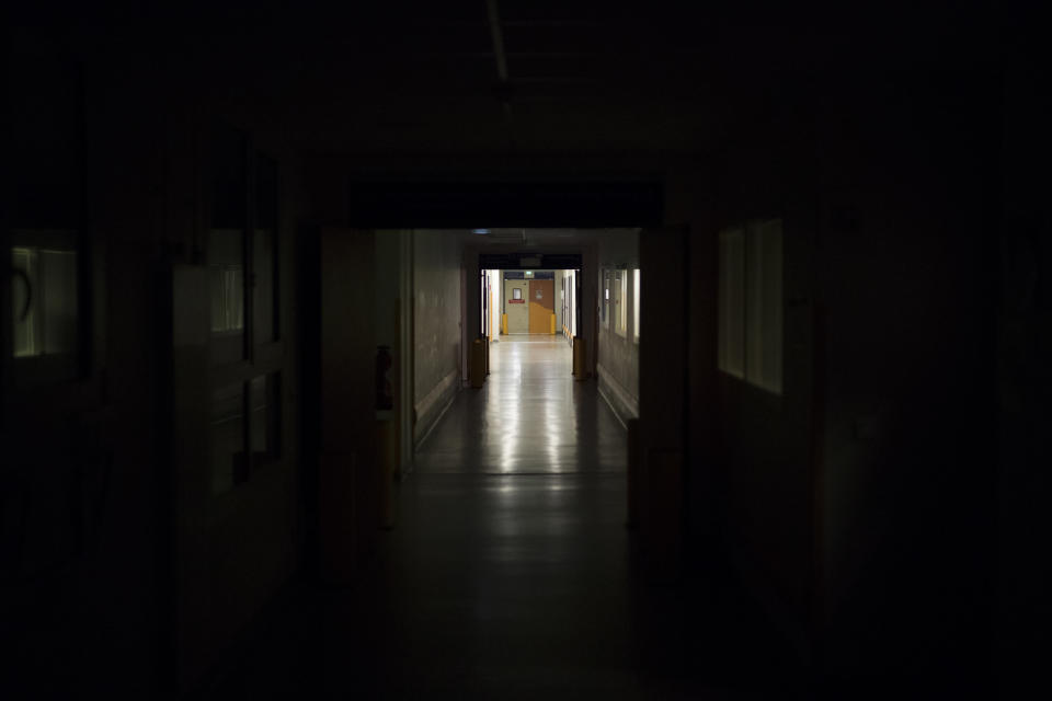 An empty corridor leading to the the COVID-19 ICU at the La Timone hospital is pictured at night in Marseille, southern France, Thursday, Nov. 12, 2020. France is more than two weeks into its second coronavirus lockdown, and intensive care wards have been over 95% capacity for more than 10 days now. Marseille has been submerged with coronavirus cases since September. (AP Photo/Daniel Cole)