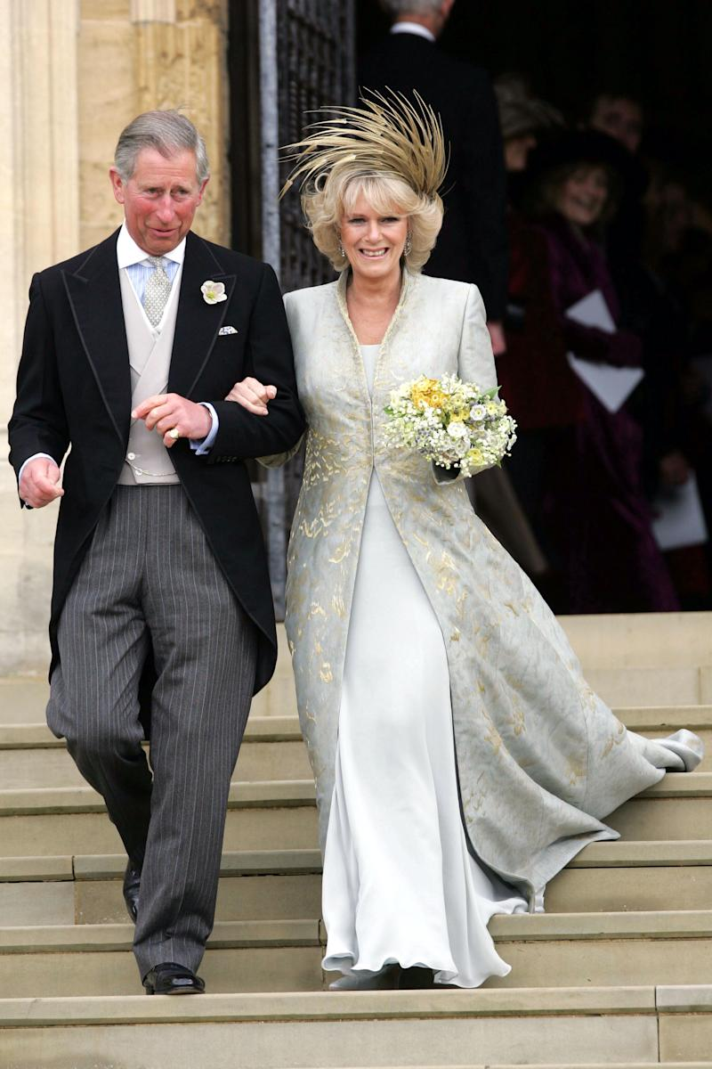 Prince Charles and The Duchess of Cornwall after a service of prayer and dedication following their wedding in April 2005, which starkly contrasted with his grand St Paul's Cathedral wedding to Princess Diana (Toby Melville / Reuters)