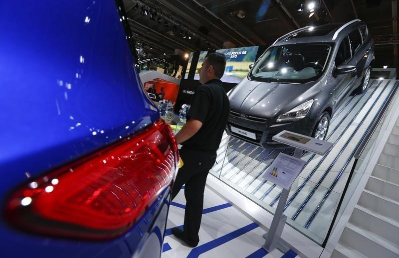 A man walks past a Ford Kuga car during the media day at the Frankfurt Motor Show (IAA) in Frankfurt