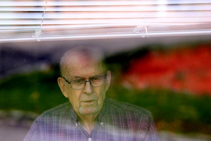 95-year-old Charles Hatton, a resident of the Tappan Zee estate, an assistant apartment building in Nyac, New York, looks out the window of his room on April 7, 2020. The building did not allow residents to receive visitors for the past three weeks due to the coronavirus pandemic.