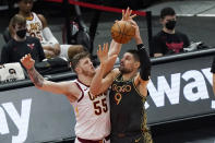 Chicago Bulls center Nikola Vucevic, right, drives to the basket against Cleveland Cavaliers center Isaiah Hartenstein during the second half of an NBA basketball game in Chicago, Saturday, April 17, 2021. (AP Photo/Nam Y. Huh)