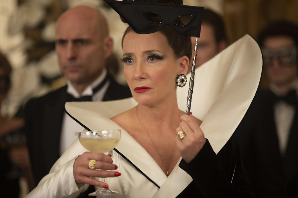 (L-R): Mark Strong as John the Valet and Emma Thompson as the Baroness in Disney's live-action CRUELLA. (Photo by Laurie Sparham/Disney)
